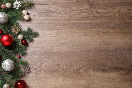 Festive Christmas decoration on wooden background, flat lay. Space for text