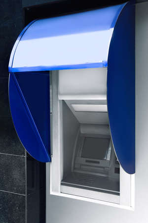 Modern color automated teller cash machine outdoors