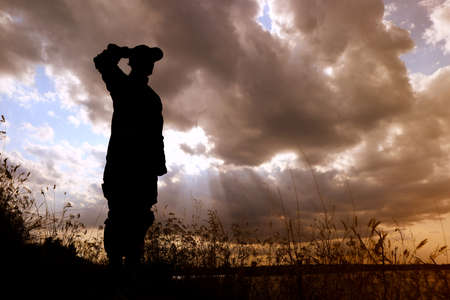 Soldier in uniform saluting outdoors. Military service 写真素材