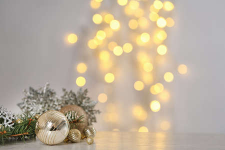 Christmas decoration on table against blurred lights. Space for text Zdjęcie Seryjne