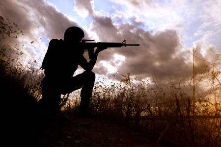 Soldier with machine gun patrolling outdoors. Military service 写真素材 - 128875920