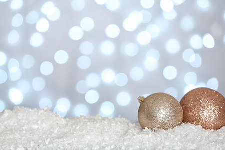 Christmas decoration on snow against blurred background, space for text Zdjęcie Seryjne