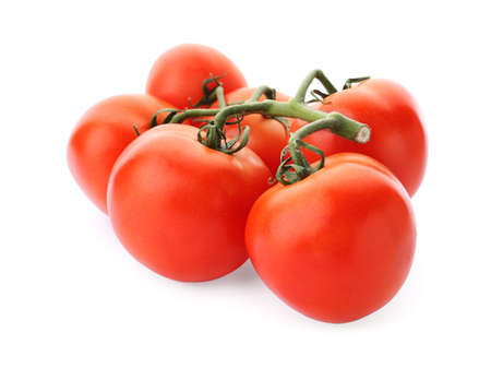 Branch of ripe red tomatoes on white background