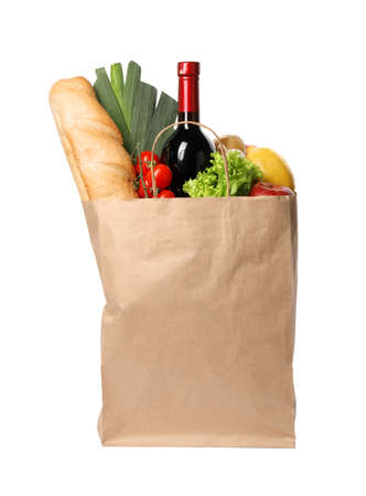 Paper bag with groceries on white background