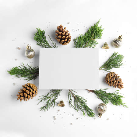 Composition with Christmas decor and blank card on white background, top view Imagens