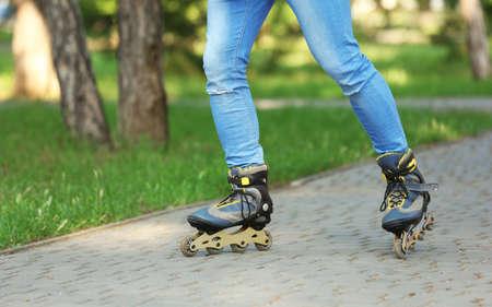 Man roller skating in summer park, closeup of legs Zdjęcie Seryjne