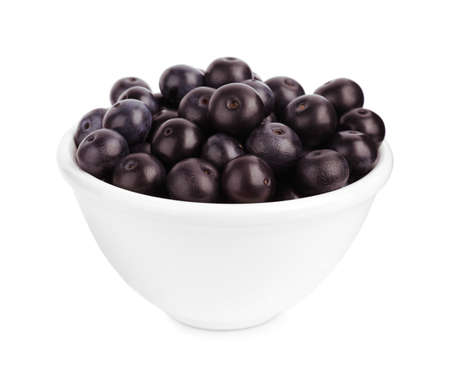 Ceramic bowl with fresh acai berries on white background