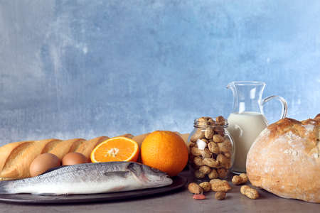 Set of natural products on table against light blue background, space for text. Food allergy
