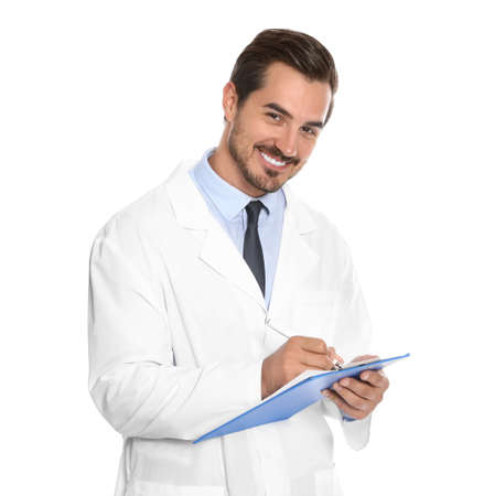 Young male doctor writing on clipboard against white background. Medical service