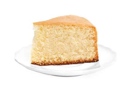 Piece of delicious fresh homemade cake on white background