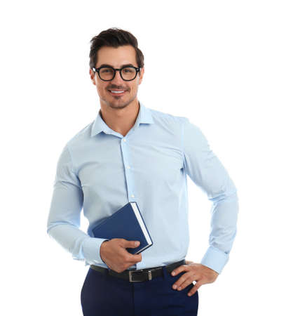 Young male teacher with glasses and book on white background