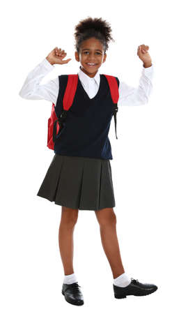 Happy African-American girl in school uniform on white background 免版税图像