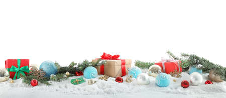 Fir branches, Christmas decoration and snow against white background