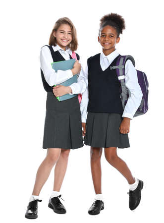 Happy girls in school uniform on white background Imagens