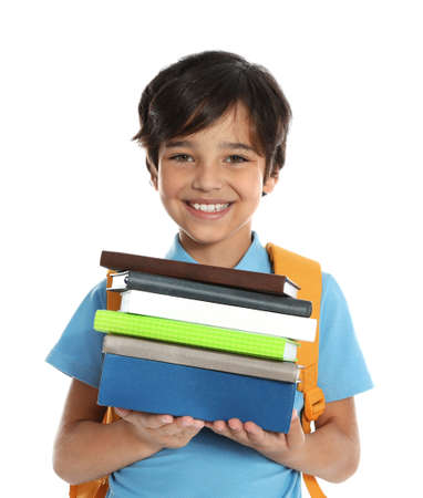 Happy boy in school uniform with stack of books on white background Stock fotó
