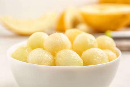 Bowl of melon balls on table, closeup