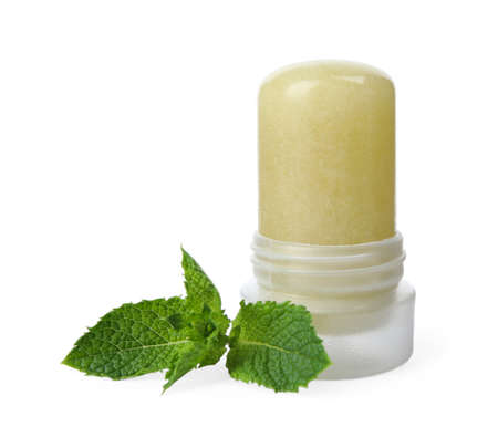 Natural crystal alum deodorant and mint on white background Stockfoto