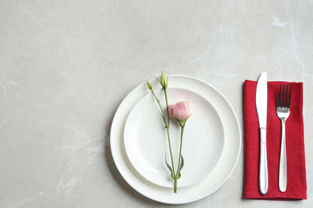 Elegant table setting on grey marble table, flat lay. Space for text Фото со стока