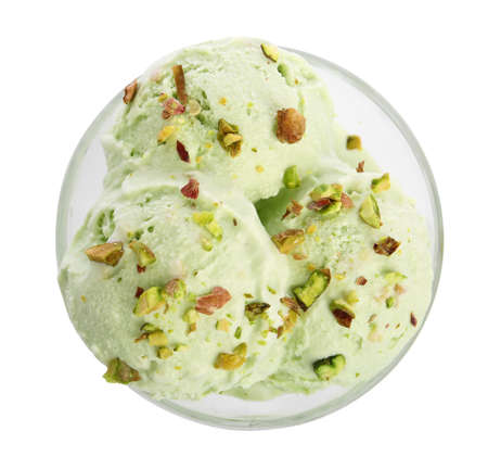 Dishware of sweet pistachio ice cream on white background, top view