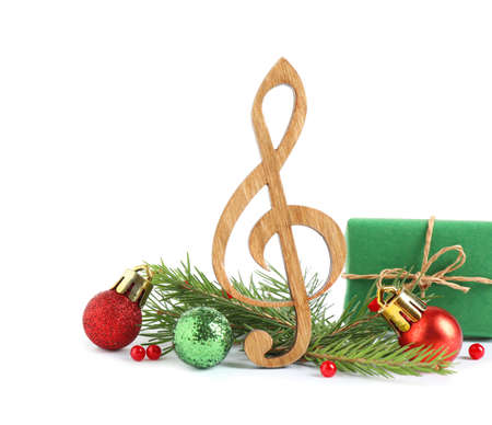 Treble clef with decorations isolated on white. Christmas music concept