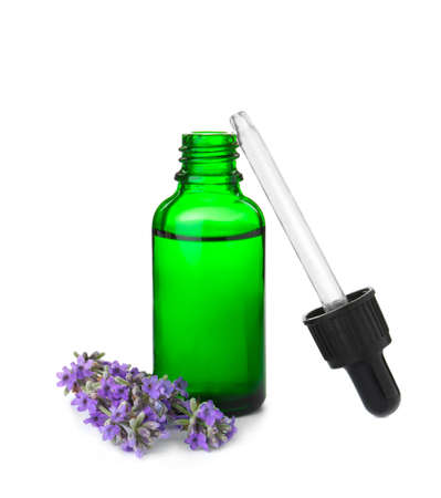 Bottle of essential oil and lavender flowers isolated on white 写真素材