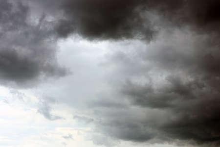 Sky with heavy rainy clouds on grey day