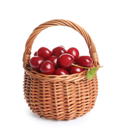 Wicker basket of delicious ripe sweet cherries on white background