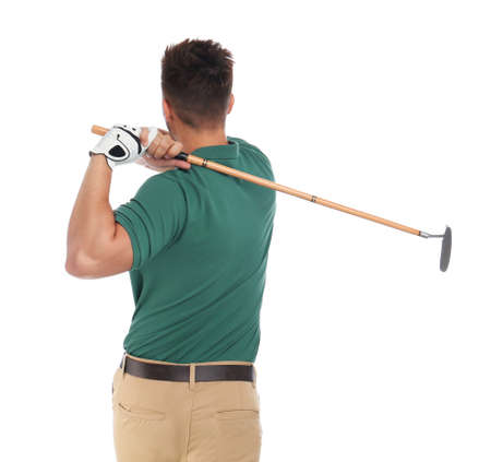 Young man playing golf on white background Фото со стока