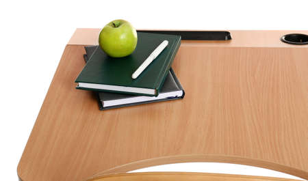 Wooden school desk with stationery and apple on white background Stock fotó