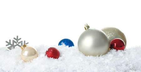 Christmas decoration on snow against white background