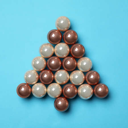 Christmas tree made of decorations on blue background, top view. Space for text Banco de Imagens