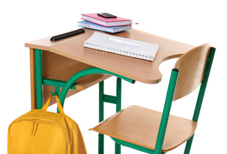 Wooden school desk with stationery and backpack on white background Standard-Bild