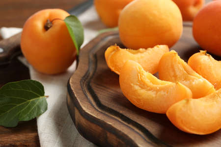 Composition with delicious ripe sweet apricots, closeup view. Space for text