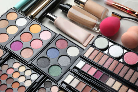 Set of different professional makeup products on table