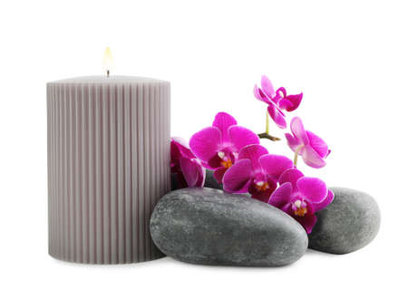Orchid with spa stones and candle on white background