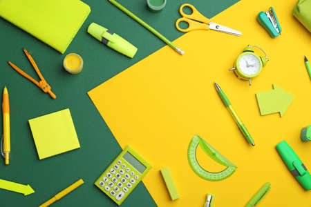 Frame of different bright school stationery on color background, flat lay. Space for text Stock fotó