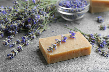 Hand made soap bar with lavender flowers on grey stone table Zdjęcie Seryjne