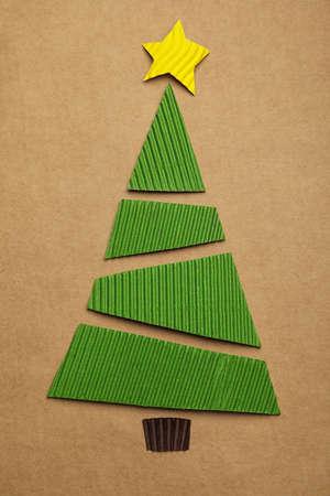 Christmas tree made of carton on kraft paper, top view
