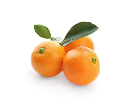 Branch of ripe tangerines isolated on white. Tasty citrus fruit Фото со стока