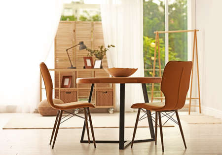 Modern dining room interior with table and chairs Zdjęcie Seryjne