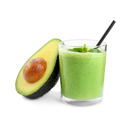 Glass of tasty smoothie with mint and avocado on white background