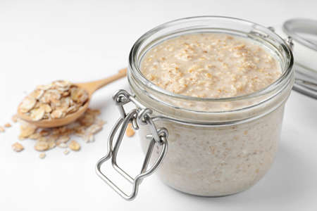 Handmade oatmeal face mask and ingredient on white background Stockfoto