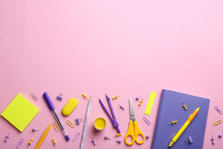 Bright school stationery on pink background, flat lay. Space for text