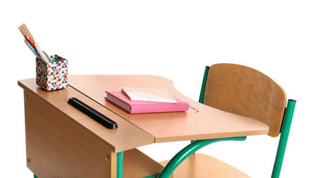 Wooden school desk with stationery on white background