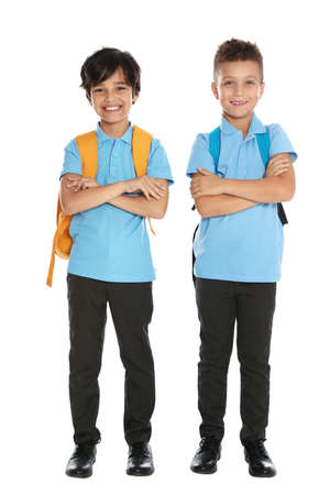 Happy boys in school uniform on white background Stock fotó