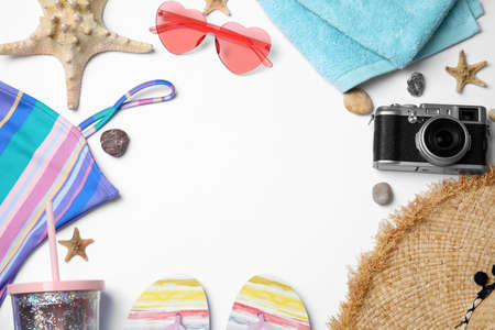 Flat lay composition with beach objects on white background. Space for text