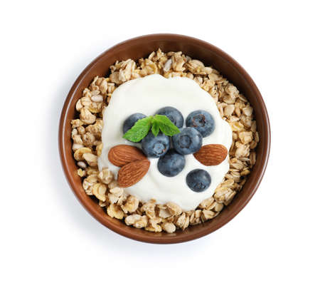 Bowl of tasty oatmeal with blueberries, yogurt and almond on white background, top view