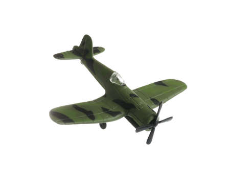 Vintage toy military airplane on white background