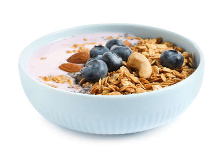 Bowl of tasty yogurt with blueberries and oatmeal on white background