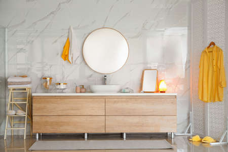 Modern bathroom interior with vessel sink and round mirror Banco de Imagens